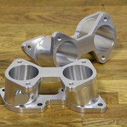 Ansaugstutzen für den 24V Zylinderkopf vom C30SE aus Senator / Omega Passend für Einzeldrosselklappen mit DCOE-Flansch